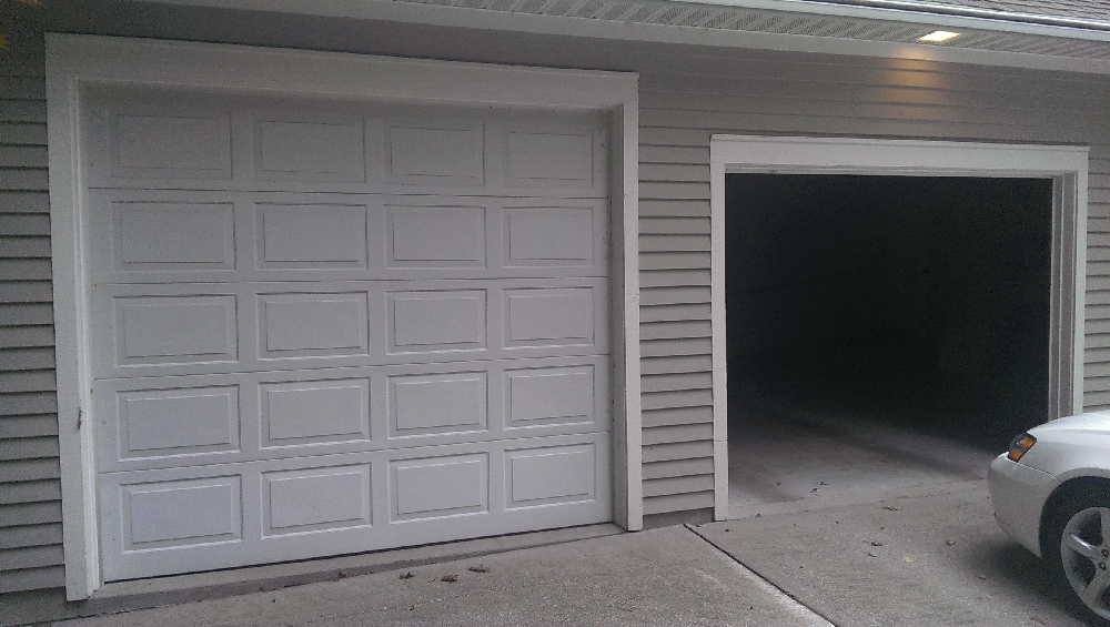 Garage - Taller door for a Kubota or John deere tractor or high top pickup or van