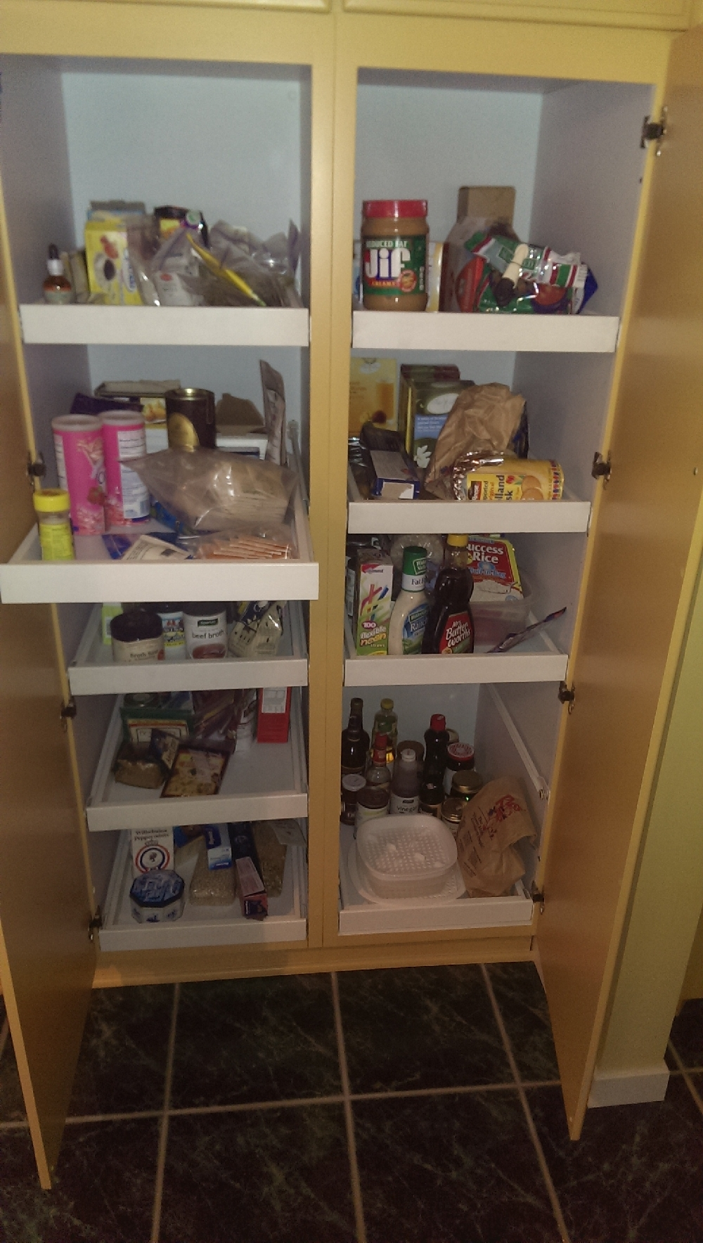 Kitchen - lazy susan style pantry with convenient roll out shelves