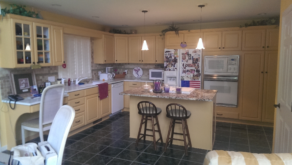 Kitchen - the updated kitchen with lots of storage space and nick knack space above cupboards