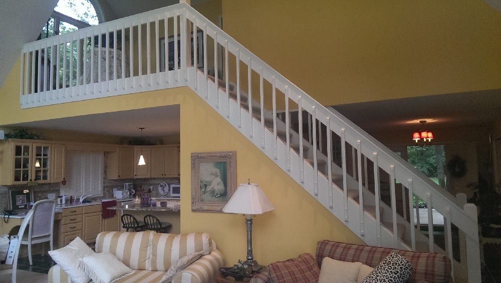 LR - gorgeous stairs and open seating area above