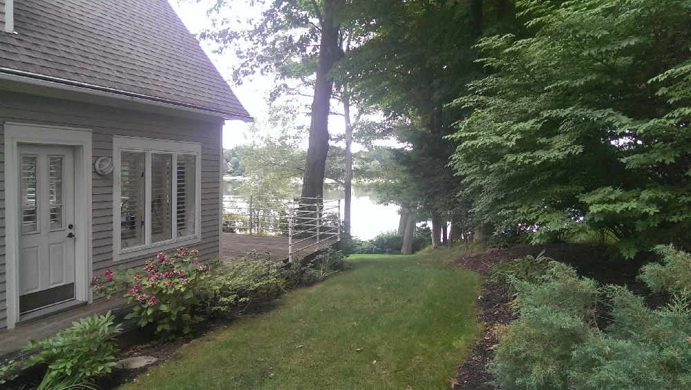 Yard - Southside of home and deck and lake view and easy access to lake